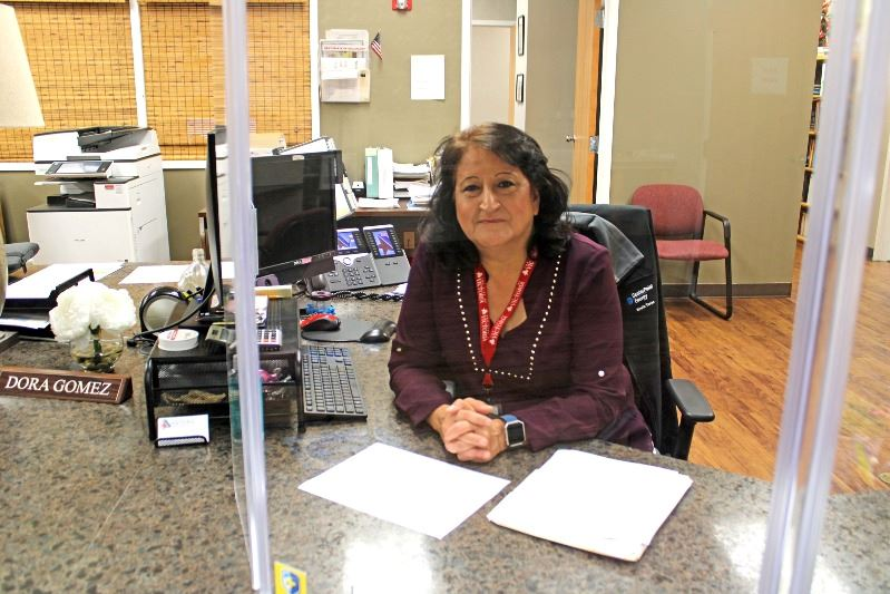 Development specialist Dora Gomez works at the front desk